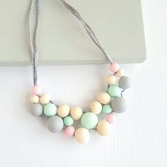 See all designs >>> Silicone Bead Pastel Statement Necklace WATERMELON. Perfect for entertaining curious little fingers... great to keep attention when feeding! These nursing necklaces are great for #mumlife!