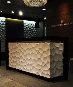 textured wall panels on desk Reception Desk Design, Reception Counter, Hotel Reception, Reception Areas, Textured Wall Panels, 3d Wall Panels, Corporate Interiors, Office Interiors, Commercial Design