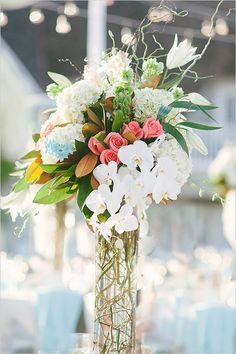 tall floral centerpieces #weddingreception #floralcenterpieces #weddingchicks http://www.weddingchicks.com/2014/04/08/sweet-southern-love-wedding/