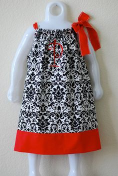 This pillowcase dress/top would be cute over white or black shirt & white/black leggings.  That way you can interchange the tops