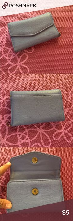 Cute wallet In good used condition. Has a insert to hold an iPhone maybe a iPhone 4 or 5. Also has insert for cards. Has a small stain of makeup on the front Bags Wallets