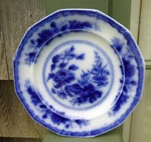 Antique Flow Blue Plate -    This antique plate has a beautiful dark cobalt color and has a delightful floral design both in the center and on the border and also on the back side of the rim. The blank is 12 sided.    $82.00
