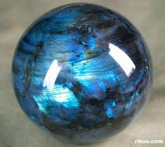 Labradorite, my boyfriend gave me a necklace made of this! only my stone is more sage/golden/teal-y (the color shifts <3)