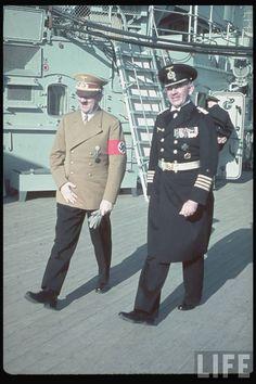 Hitler and an unidentified naval captain aboard the battleship Scharnhorst.
