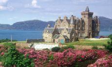 Looking over gardens to Glengorm Castle, Isle of Mull - Unusual places to stay in Scotland (castles, boat houses, lighthouses, barges, yurts, and the like)