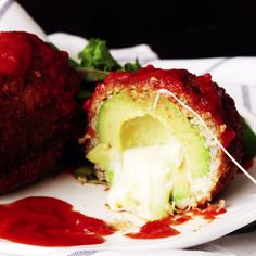 What part of a cheese-filled, pork-wrapped fried avocado doesn't sound amazing?yum show your cook this Pork Recipes, Mexican Food Recipes, Cooking Recipes, Healthy Recipes, Avocado Fries, Fried Avocado, Fried Stuffed Avocado, Avocado Recipes, Food Videos