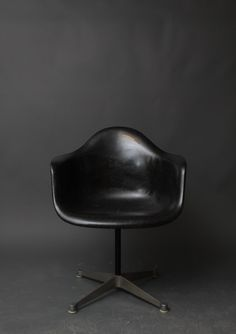 Hey, I found this really awesome Etsy listing at http://www.etsy.com/listing/125566361/vintage-herman-miller-eames-black