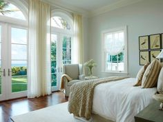 A guest bedroom with french doors to a balcony and ocean views - who wouldn't love staying here?