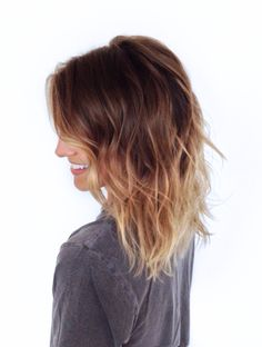 gorgeous mid length haircut with blonde tips... super texturized, messy, kinda beachy hair. however you want to describe this hair style, it's beautiful!