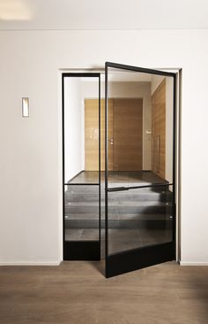 Swing door made of aluminum and glassRevolving glass door made of bronze-colored anodized aluminum with invisible self-closing pivot system. The design of the door is fully Trendy glass door frame Trendy Glass Door Steel Doors And Windows, Steel Frame Doors, Metal Doors, Wrought Iron Doors, Pivot Doors, A Frame Cabin, Entrance Doors, Front Doors, Entrance Ideas