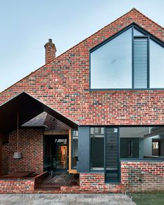 The alterations and additions to Tudor Revival residence designed by of Warc Studio was a pleasure project for the… Brick House Designs, Brick Design, Facade Design, Brick Facade, Facade House, Brick Houses, Red Brick Exteriors, Industrial House, Industrial Kitchens
