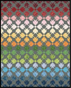 Have you seen those vivid photos of rows upon rows of richly colored tulips in Holland?  Perhaps you've been fortunate enough to see fields of flowers like that yourself?  This quilt design by Robert Kaufman Fabrics brings that experience to mind, and we love the Garden collection from Kona Cotton Fusions® they used for this project. http://www.freequiltpatterns.info/free-pattern---garden-path-quilt-from-robert-kaufman-fabrics.htm