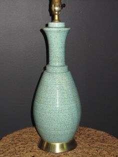 """""""The Cottage Seabreeze"""": seafoam ceramic with horizontal striation and brown speckles, 19""""H."""