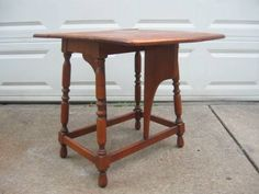 Willett Furniture..drop leaf end table with wing shaped supports