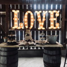 Whiskey barrels with antique door, metal cupcake stand(photo by Apple Blossom Café and Catering)