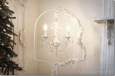 chandelier hanging in bird cage stand