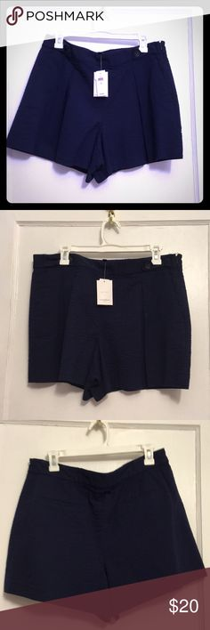 """Navy Blue Cotton Shorts Navy blue cotton """"pebbled"""" effect seersucker shorts from Banana Republican. Some threads loose at the top of the side zipper, as shown in the bottom most photo. NWT. Banana Republic Shorts"""
