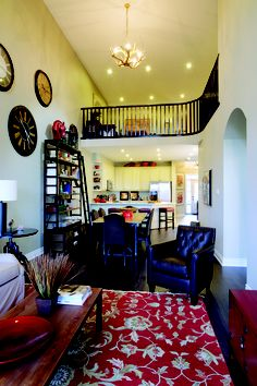 Love the red accents in this Living Room Model Home The Village at Sally Creek  Woodstock Ontario #geraniumhomes