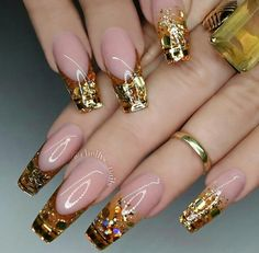 """If you're unfamiliar with nail trends and you hear the words """"coffin nails,"""" what comes to mind? It's not nails with coffins drawn on them. It's long nails with a square tip, and the look has. Glam Nails, Hot Nails, Fancy Nails, Bling Nails, Trendy Nails, Gold Glitter Nails, Purple Glitter, White Glitter, Beautiful Nail Designs"""