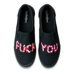 Somehow, when artist Kelsey Flones writes out expletives in her artful, vibrant flowers, the message transforms into something playful and instantly eye-grabbing on these all-black pair of canvas slip-ons. The meaning of the statement isn't what you think, though. Kelsey intended for this art to remind people to see the good within the bad, the positive with in the negative, and the light in all things and people—even when they seem dark or offputting.</p><ul><li>Slip on…
