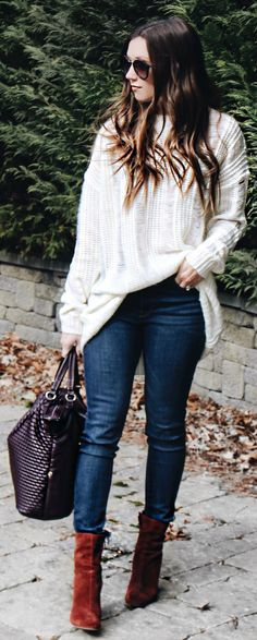 #spring #fashion /  White Oversized Knit / Navy Skinny Jeans / Brown Velvet Booties