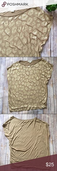 Michael Kors Gold Sequin Tee This is a beautiful MICHAEL Michael Kors gold sequin tee. Short sleeves. Missing some sequins, has some pilling, and has two teeny tiny pinholes at the back neckline. Still in great condition otherwise and has lots of life left! 😉  🌟SUGGESTED USER 🚫NO TRADES 🚫NO MODELING ✅DOG FRIENDLY 🐶, 🚭 SMOKE FREE HOME ✅I 💗 REASONABLE OFFERS 🔵 PLEASE USE OFFER BUTTON!  ❓ASK IN THE COMMENTS!   🔹🔹🔹BUNDLE 2+ ITEMS & SAVE!!!🔹🔹🔹 MICHAEL Michael Kors Tops Tees - Short…