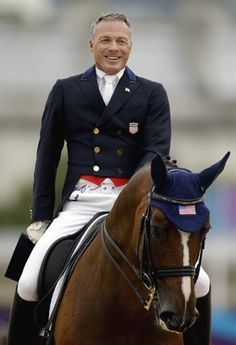 Rafalca's Tuesday Ride - Equestrian Jan Ebeling of the United States smiles after competing in the equestrian dressage competition with his horse Rafalca, Aug 7th (day 11)