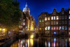 Amsterdam.  The red light district captured at night.  I love this city.  It's got the best style.  photo, etsy, link: http://www.etsy.com/listing/24101628/rode-lichte-schoonheid