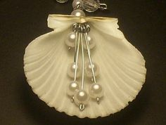 Shell Jewelry By La Roca Fan Shell by LaRocaGallery on Etsy, $30.00. I think I can make this mysef !!!