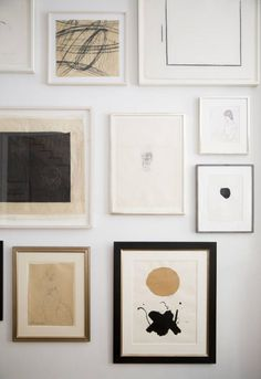 Gorgeous black, gold, white gallery wall. Ali Cayne Gallery Wall | Remodelista