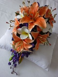 orange tiger lilys, orchids, and frangipanis.a very thin green ribbon with something like this would be ok. Tiger Lily Wedding, Lily Bouquet Wedding, Purple Wedding Bouquets, Bride Bouquets, Floral Bouquets, Wedding Colors, Wedding Flowers, Wedding Dresses, Tiger Lily Bouquet