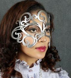 Swirly leather mask in Silver. $39.00, via Etsy.
