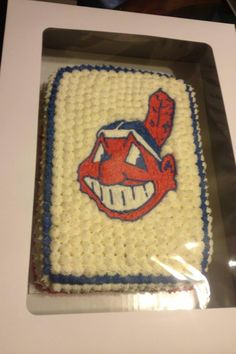 Chief Wahoo Indians cake I made my friend's son. I printed a picture of the chief them traced over it on rice paper with edible markers, then piped over my drawing with icing to make sure the image looked right.