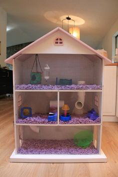 I converted a dollhouse bookcase (available at Target) into a hamster palace for my daughter.