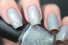 Colors by llarowe Fairy Dust - is a white jelly scattered holographic with multi sized holo shimmer and micro glitter 2-3 coat coverage. Swatch by Beaching Nails.