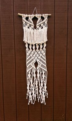 Check out this item in my Etsy shop https://www.etsy.com/listing/236924365/sale-macrame-fringe-wall-hanging-large