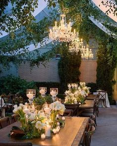 The things tent dreams are made of! Just look at the stunning #weddingdecor - greenery, chandeliers and candlelight for a romantic outdoor wedding. #OutdoorWedding #TentWedding