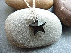 Black Swarovski Star Necklace with sparkly Swarovski crystal beads in shades of grey and clear. This is a pretty pendant charm necklace,