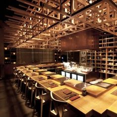 A sprawling grid of timber cubes covers the ceiling of a restaurant in Singapore.