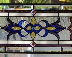 Beautiful Stained Glass Window Hanging ... measures 23 3/4 X 10 3/4 ..... ..Polished .Brass Frame (edging)....hangs either way....custom orders are what I do....visit: stevesartglass
