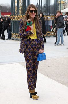 Anna dello Russo Photos - Anna Dello Russo arrives at the Valentino Fall/Winter fashion show, part of the Paris Womenswear Fashion Week, held at the Jardin des Tuileries in Paris. - Arrivals at the Valentino Fashion Show