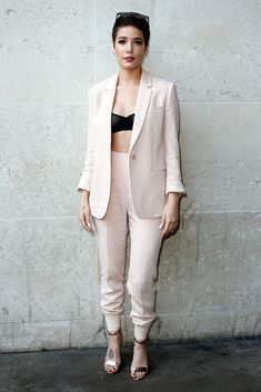 Halsey bossing it in the pale pink suit of our dreams.