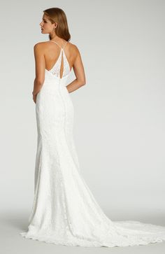 Style 7707 Ti Adora by Allison Webb bridal gown - Ivory re-embroidered lace over Charmeuse trumpet bridal gown. V-neckline with spaghetti straps and an open sheer lace back with buttons over zipper to the end of the train. Alvina Valenta Wedding Dresses, Bridal Gowns, Wedding Gowns, Wedding Wishlist, Wedding Silhouette, Bohemian Bride, Boho, Silk Charmeuse, Bridal Boutique
