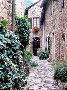 stone house and sidewalk