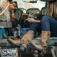 Frye Cognac Brown Harness Boots - 8 Frye knows there's nothing quite like a cowboy boot, so it made the Harness Boot to be as classic as they come, with a soft oiled leather upper, tough rubber sole, and 1.75-inch heel for a a little bit of lift. The Harness has a classic brass o-ring, too, with riveted leather straps wrapping around your foot for a touch of support and a whole lot of style.? These are in good preloved condition, with minor wear to the leather, and a broken-in, easy fit…