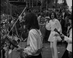 This clip from 1969 shows the Rolling Stones' performance in Hyde Park - despite the death of Brian Jones only 2 days earlier: http://www.britishpathe.com/video/rolling-stones-concert-1
