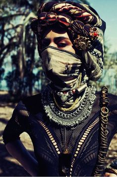 I like the multilayered headdress and also face mask.