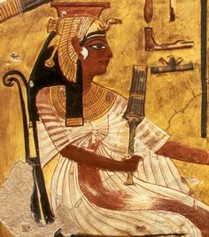 Painting of Queen Nefertiti from her tomb. She is playing a game of senet.  On her head is the vulture headdress of a queen.