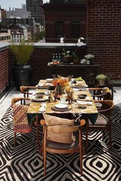 Live outside - rug by Diane Von Furstenberg for The Rug Company.  Vintage Danish chairs.