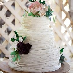 The white pound cake, wrapped in ruffles of fondant with a light ombre gradient, was adorned with sugared peonies and succulents.